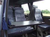 Tables and aircraft style lockers over the seating available in this 12-seater minibus. MInibus hire from Sweeneys of Muthill, Perthshire, Scotland, UK